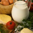 Stock Photo: Rural still-life with milk and greens