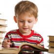 Happy young boy with books — Stock Photo