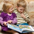 Boy and girl with the book — Stock Photo #1721267