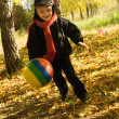 Boy with ball in autumn park — Stock Photo #1721285