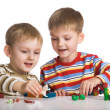 Stock Photo: Boys mould toys from plasticine