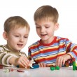 Boys mould toys from plasticine — Stock Photo #1721359