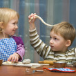 Small girl and the boy help on kitchen — Stock Photo