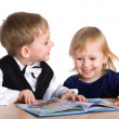 Small girl and boy read the book — Stock Photo #1722243