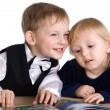 Stock Photo: Small girl and boy read the book