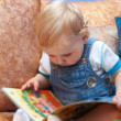 Baby boy with book - Stock Photo