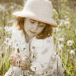 Little girl with dandelions — Stock Photo