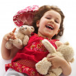 Laughing little girl with toys — Stock Photo