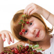 Little girl with cherry — Stock Photo