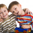 Stock Photo: Two young boys cheerfully play