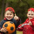 Happy kids with a ball — Stockfoto