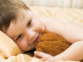 Cheerful kid with teddy bear — Stock Photo