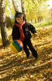 Boy with ball in autumn park — Stock Photo