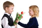 Nice boy gives tulips to girl — Stock Photo