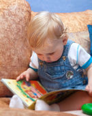 Baby boy with book — Stock Photo