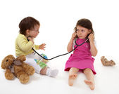 Little doctor and small patient — Stock Photo