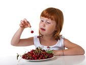 Redheaded little girl with cherry — Stock Photo