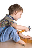 Child with hammer — Stock Photo