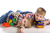 Cheerful boys lay on a floor — Stock Photo