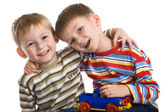 Two young boys cheerfully play — Stock Photo