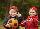 Happy kids with a ball — Stock Photo