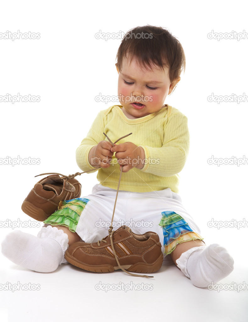 Baby with big boots — Stock Photo #1723495