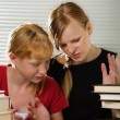Stock Photo: Sisters do lessons