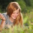 Pretty girl on a grass — Stock Photo