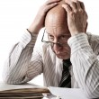 Stock Photo: Problems of old accountant