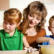 Mother with children in kitchen — Stok fotoğraf