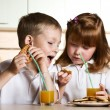 Children drink juice — Stock Photo