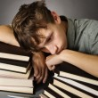 Tired teenage boy - Stock Photo