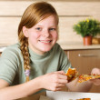 Teenage girl with pizza — Stock Photo