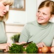 Stock Photo: Mother and daughter cook food