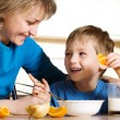 Happy mother and son in kitchen — Stock Photo