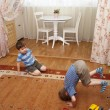 图库照片: Children plays on a floor