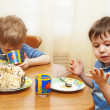 Royalty-Free Stock Photo: Children eat a pie