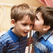 Foto Stock: Boys telling secrets