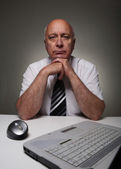 Responsible man with laptop — Stock Photo