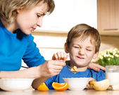 Patient mother and naughty son — Stock Photo