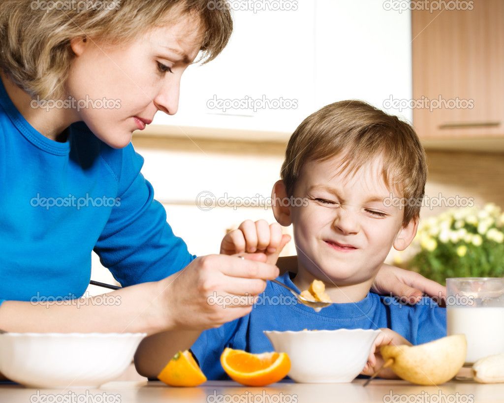 Patient mother and naughty son — Stock Photo #1733528