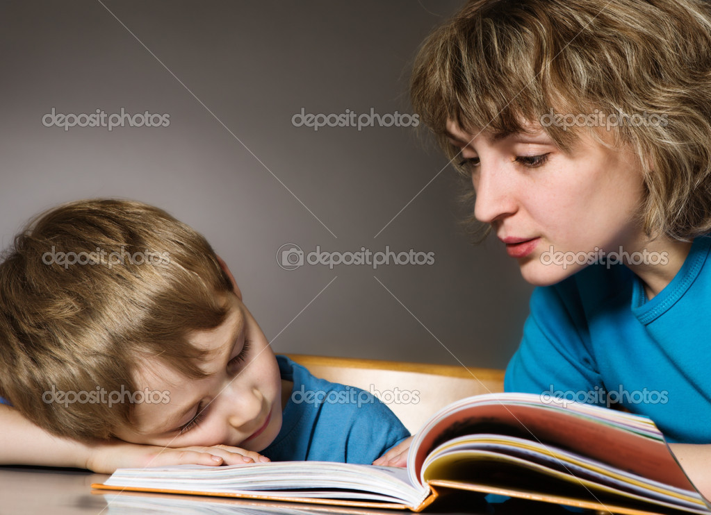 Tired son and affectionate mother — Stock Photo #1733691
