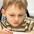 Kid draws a picture — Stockfoto