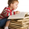Kid with a pile of books — Stock Photo
