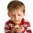 Foto Stock: Kid with old clock