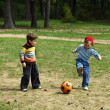 Two kids with a ball — Stock Photo
