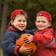 Two happy kids with a ball — Stock Photo