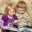 Boy and girl with the book — Stok fotoğraf