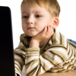 Young boy using a laptop — Foto de Stock