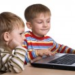 Two brothers play computer games - Stock Photo